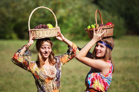 Young girls with a fruit baskets photo