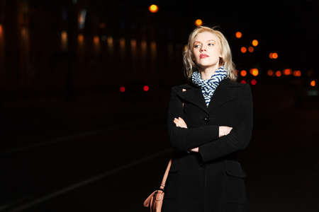 Young woman on the night city street Stock Photo - 16483587