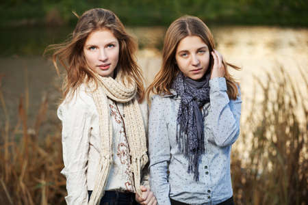 Young girls in an autumn park Stock Photo - 16494740