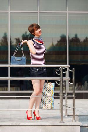 window shopper: Young woman against a shop window Stock Photo