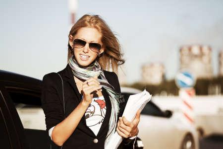 Happy businesswoman on the city street