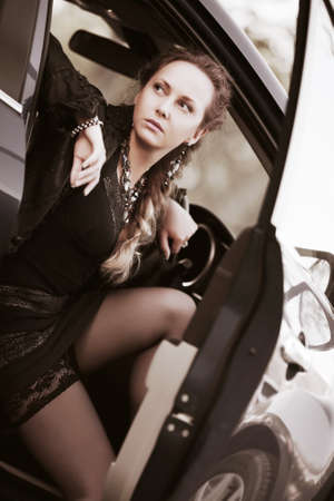 Beautiful woman sitting in a sports car photo