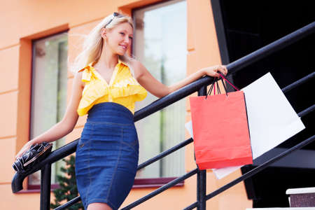Young woman with shopping bags Stock Photo - 16545487