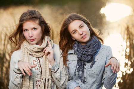 Young girls against an autumn nature photo