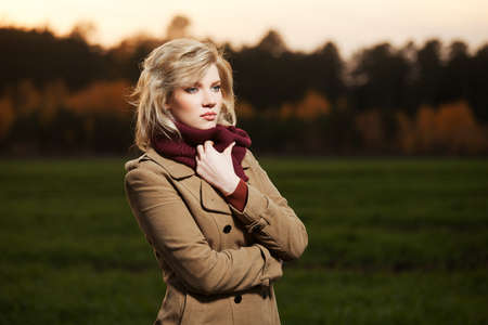 Young woman walking in autumn field Stock Photo - 17206410