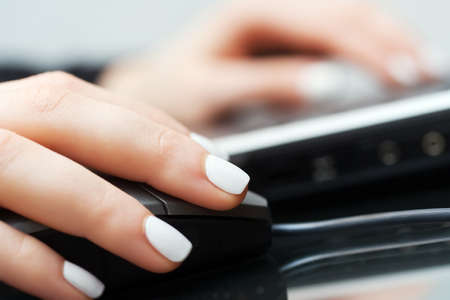 Female hands using laptop photo