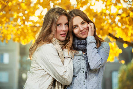 Young girls in an autumn park photo