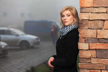 Young woman in autumn foggy morning Stock Photo - 17480389
