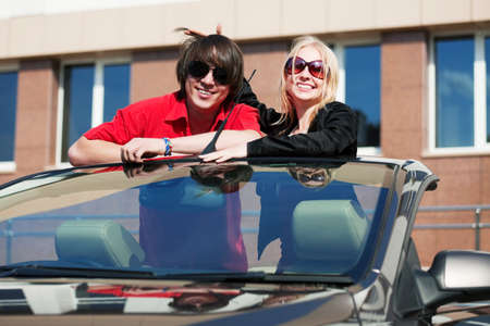 Happy young couple in a convertible car Stock Photo - 17538350