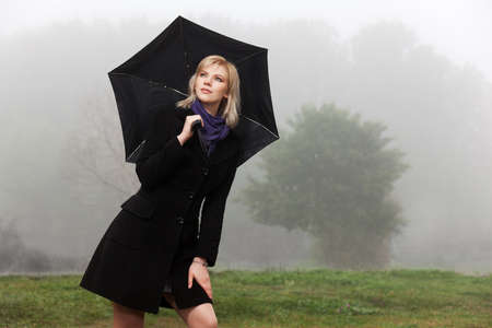 Young woman against a morning foggy landscape Stock Photo - 18062900