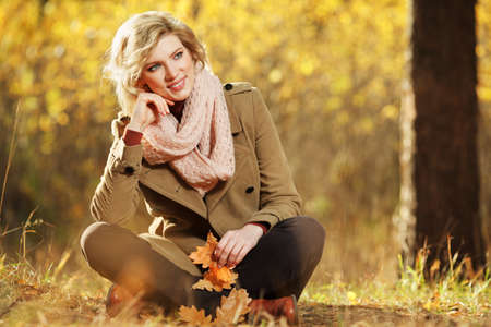 Young blond woman in autumn forest Stock Photo - 18231216