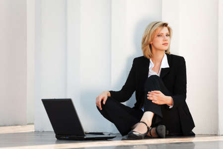 Young businesswoman with laptop  photo