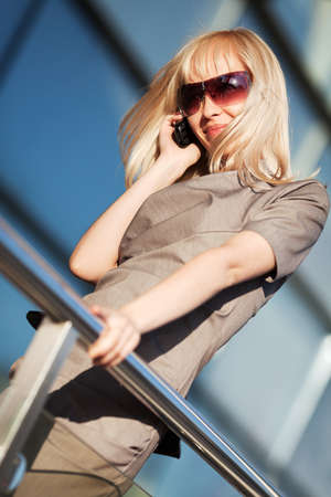 Blond businesswoman calling on the phone photo