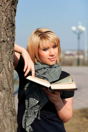 Young woman with a book photo