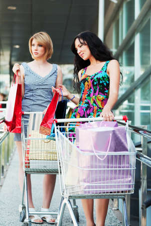 Young women with shopping carts photo
