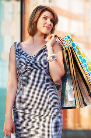 Happy young woman with shopping bags photo