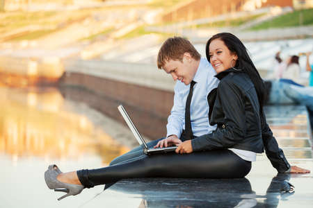 Young business couple using laptop  photo