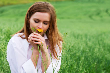 Happy young woman with wild flowers  photo