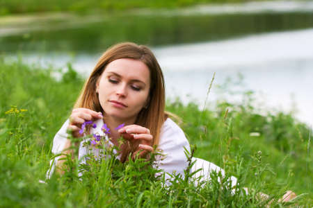 Young woman relaxing in the grass photo