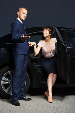 Young business couple at the car photo