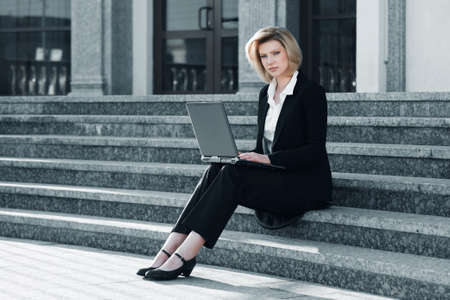 Young business woman with laptop photo