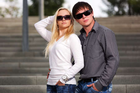 Young fashionable couple on the steps photo