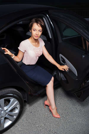 Young woman in the car photo