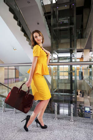 Happy young business woman in office interior photo
