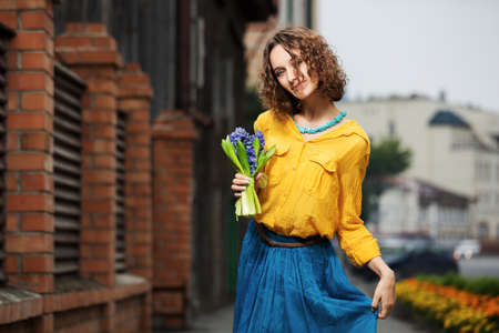 Happy young woman with bouquet of flowers Stock Photo - 23176033