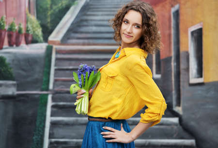 Happy young woman with bouquet of flowers Stock Photo - 23176040