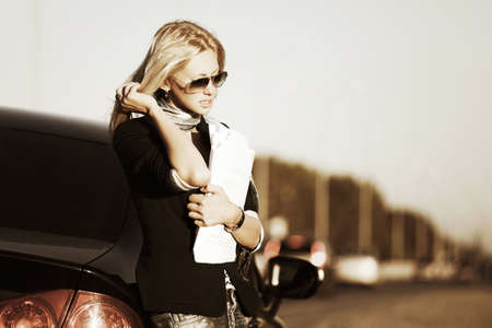 Business woman with financial papers at the car photo