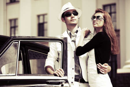Young couple at the retro car  photo