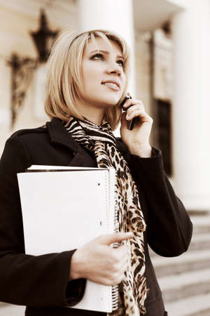 Young business woman calling on the phone photo