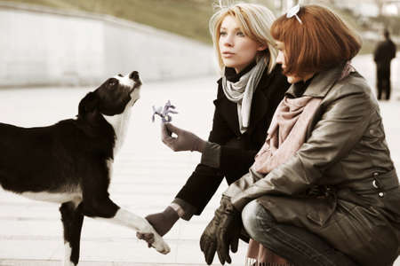 Two young women and a dog photo