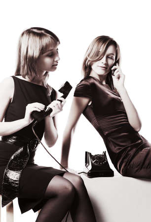 Young women with a retro and modern phones photo