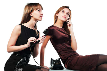 Two young women with a retro and cell phones photo
