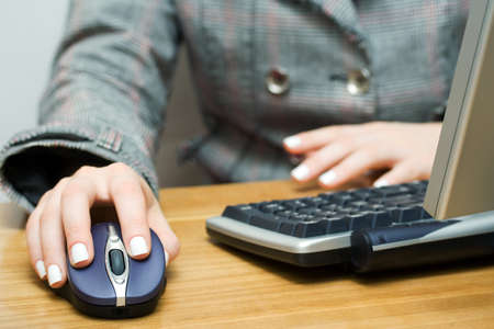 Female hand holding computer mouse photo