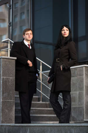 Young business couple against office building photo