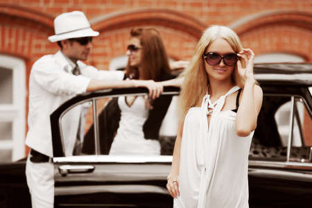 road of love: Young people at the retro car Stock Photo