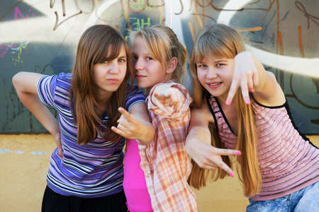 Teenage girls having fun and making peace sign photo