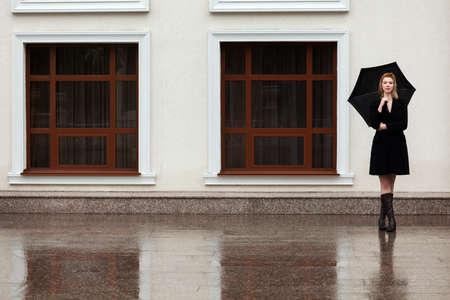 rain umbrella: Happy woman with umbrella in the rain
