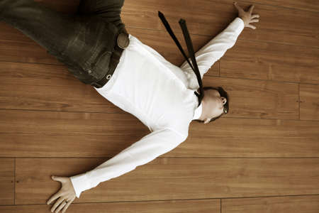 Young man in despair lying on the floor photo