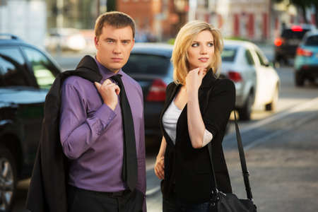 Young business couple on the city street photo