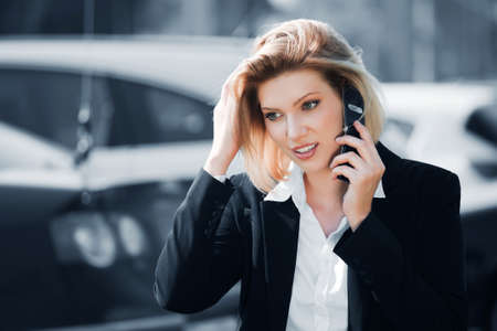 Young business woman calling on the cell phone photo
