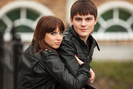 Happy young couple in leather jackets outdoor photo