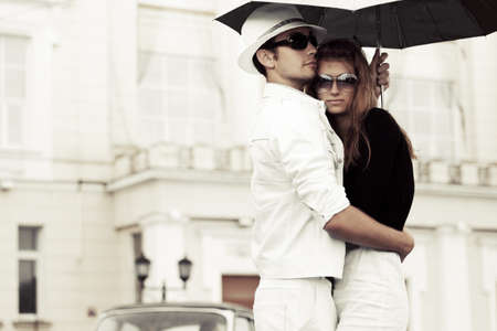 Young couple in love with umbrella photo