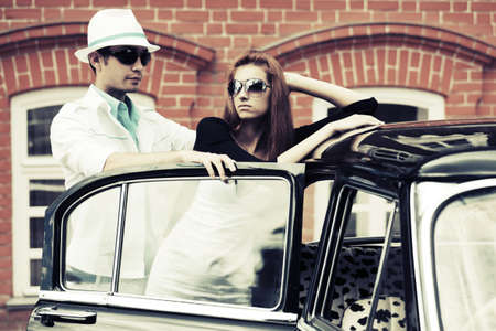 Young fashion couple at the retro car photo