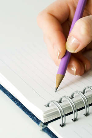Female hand writing in notebook  photo
