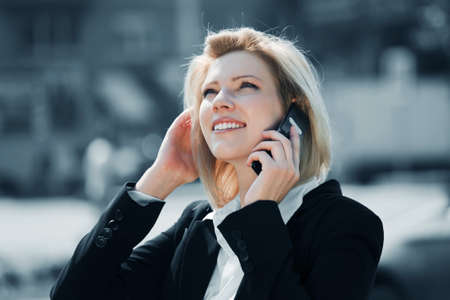 Young business woman calling on the mobile phone photo
