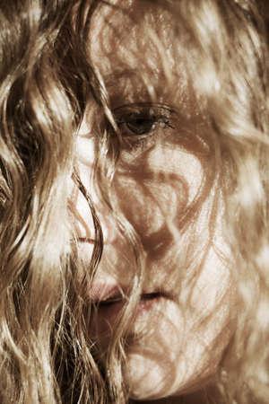Close-up portrait of sad beautiful woman photo